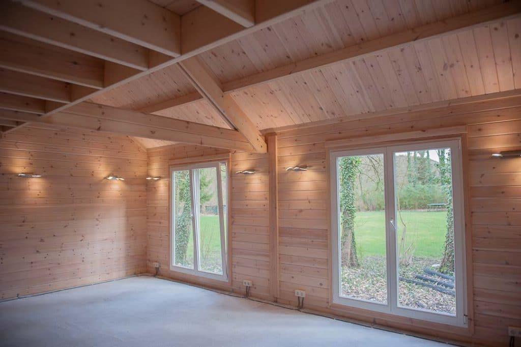 Les luminaires au bout des doigts dans une maison en bois for Exposition d une maison